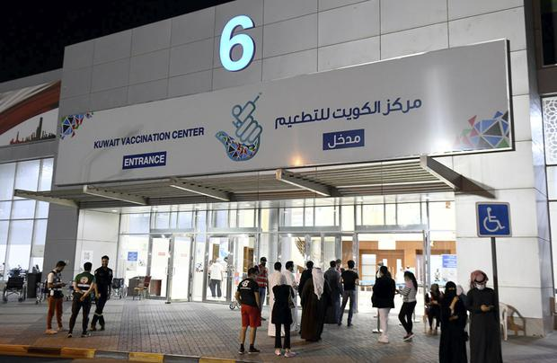 People entering the Kuwait Vaccination Centre (Kuna/AP)
