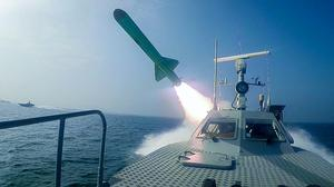 A Revolutionary Guard's speedboat fires a missile during a military exercise (Sepahnews via AP)