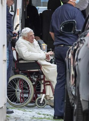 Emeritus Pope Benedict XVI is pushed in to a bus in a wheelchair, in Regensburg, Germany during a recent visit to see his brother Georg (Daniel Karmann/AP)