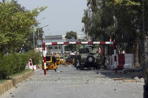 The fighting killed at least 29 people and wounded 50, authorities said (Rahmat Gul/AP)