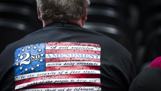 NPeople in the audience wait for the start of the NRA Convention (Smiley N. Pool/The Dallas Morning News via AP)