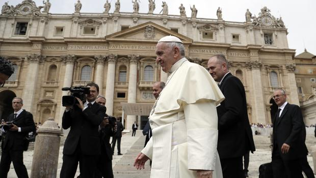 Pope Francis leaves at the end of his weekly general audience (Andrew Medichini/AP)