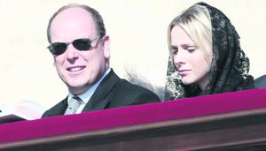 VATICAN CITY, VATICAN - MARCH 19:  Prince Albert II of Monaco and Princess Charlene attend the Inauguration Mass of Pope Francis in St. Peter's Square for his Inauguration Mass on March 19, 2013 in Vatican City, Vatican. The inauguration of Pope Francis is being held in front of an expected crowd of up to one million pilgrims and faithful who have crowded into St Peter's Square and the surrounding streets to see the former Cardinal of Buenos Aires officially take up his position. Pope Francis' inauguration takes place in front his cardinals, spiritual leaders as well as heads of states from around the world and he will now lead an estimated 1.3 billion Catholics.  (Photo by Franco Origlia/Getty Images)