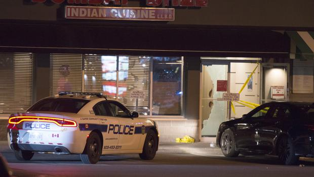 Police stand outside the Bombay Bhel restaurant in Mississauga