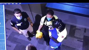 This image made from Oct. 2, 2020 surveillance camera footage obtained by the website Doha News shows officials care for an abandoned baby at Hamad International Airport in Doha, Qatar. Qatar apologized Wednesday, Oct. 28, 2020, after authorities forcibly examined female passengers from a Qatar Airways flight to Sydney to try to identify who might have given birth to the abandoned newborn baby, even as Australia said it was only one of 10 flights subjected to the searches. (Doha News via AP)