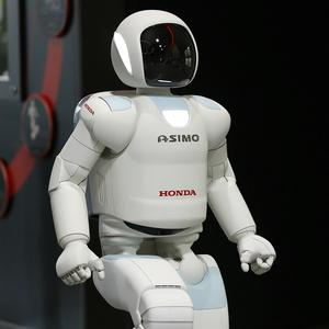 Honda's Asimo robot is trying out a new career as a museum guide (AP)