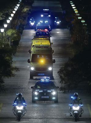 Police escort an ambulance transporting the Spanish nurse infected by Ebola to Alcorcon Hospital in Spain
