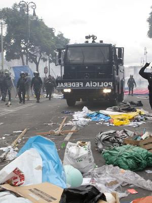Riot police enter the Zocalo in a mass eviction operation to remove striking teachers, in Mexico City (AP/Christian Palma)