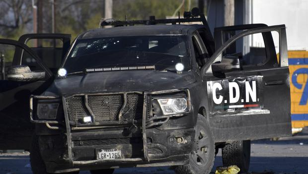 A damaged pick-up marked with the initials CDN, that in Spanish stands for Cartel of the Northeast, is left on the streets after the gun battle (Gerardo Sanchez/AP)