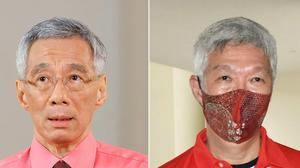Lee Hsien Loong and Lee Hsien Yan (Singapore government/Risa Suzuki/AP)
