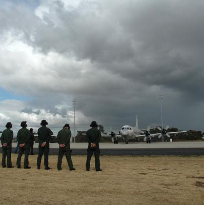Ground crew at RAAF Base Pearce watch a Japanese P-3C Orion depart on Japan's final search flight for the missing Malaysian plane (AP)
