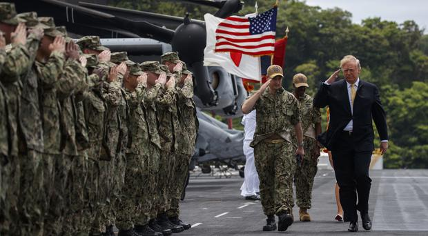 Donald Trump arrives aboard the USS Wasp (AP/Evan Vucci)
