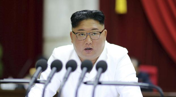 North Korean leader Kim Jong Un speaks during a Workers' Party meeting in Pyongyang on Sunday, where he called for 'offensive measures' to be put in place to protect the country ahead of his year-end deadline for the US to make concessions on nuclear negotiations (Korean Central News Agency/Korea News Service/AP/PA)