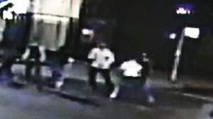 A group of people, including Spencer Stone, are captured on CCTV fighting outside a bar in Sacramento (A&P Liquors/AP)