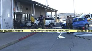 Deputies and firefighters stand outside the Red Bluff Walmart distribution centre after a man reportedly opened fire and rammed his vehicle into the building (Damon Arthur/The Record Searchlight/AP)