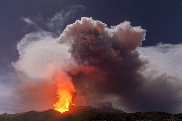 Glowing lava is seen coming from Mount Etna (Salvatore Allegra/AP)