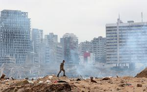 A soldier walks at the devastated site of the explosion in the port of Beirut