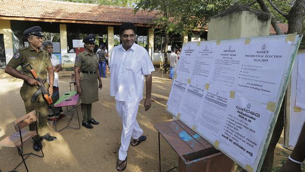 The presidential candidate from Sri Lanka's governing party Sajith Premadasa leaves after casting his vote in Weerawila, Sri Lanka on Saturday (Chamila Karunrathne/AP)