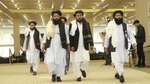 Afghanistan's Taliban delegation arrive for an agreement signing between Taliban and US (Hussein Sayed/AP)