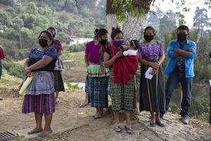 Indigenous people gather to receive food aid from their city council at El Hato village, Guatemala (Moises Castillo/AP)