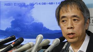 Japan's meteorological agency volcanology division director Sadayuki Kitagawa speaks during a news conference on the eruption of Mount Aso (AP)