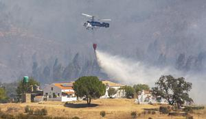 A helicopter at work trying to tackle the blaze (A Perez, Europa Press via AP)