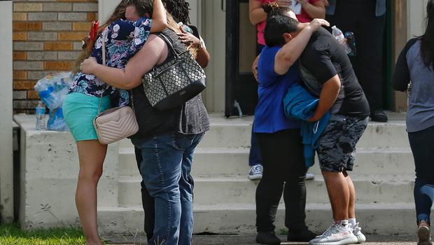 Students and parents wait to reunite after the shooting