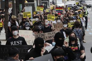 People wear face masks in a Black Lives Matter protest in Seoul, South Korea, where schools reopened on Monday (Ahn Young-joon/AP)