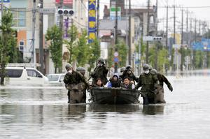 Members of Japan's military have been called up to assist with rescue efforts (Juntaro Yokoyama/Kyodo News/AP)
