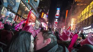 Chris and Chelsea Crawford from Scotland share a kiss at midnight in Times Square, New York (AP)
