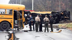 Authorities work the scene of an accident involving two school buses in Knoxville (AP)
