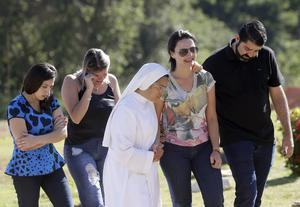 Friends and relatives attend the burial of Vale SA employee Edgar Carvalho Santos (Andre Penner/AP)