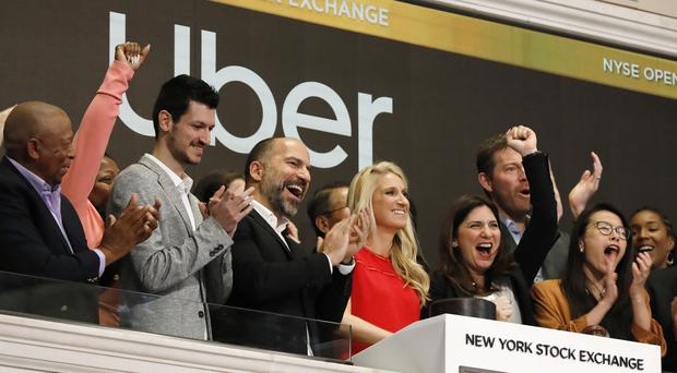 Uber staff attend the opening bell ceremony at the New York Stock Exchange (Richard Drew/AP)