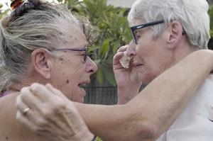 Christine Archer, right, and her sister Gail Baker are reunited (AuBC via AP)