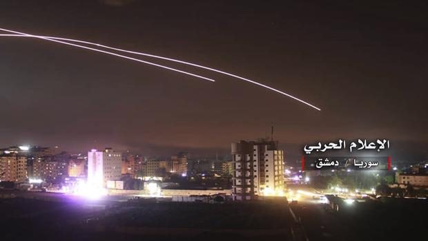 Missiles rise into the sky (Syrian Central Military Media, via AP)
