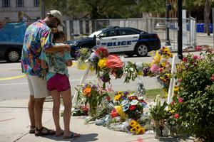 People visit a makeshift memorial near the Emanuel AME Church in Charleston where nine people died in a shooting
