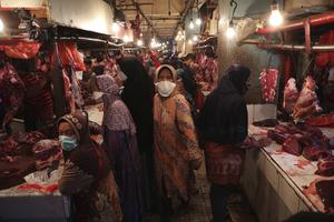 Muslim women shop in Jakarta, Indonesia, for meat in preparation of the upcoming Eid al-Fitr holiday (Achmad Ibrahim/AP)