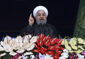 Iranian President Hassan Rouhani spoke from a podium in Tehran (AP Photo/Vahid Salemi)