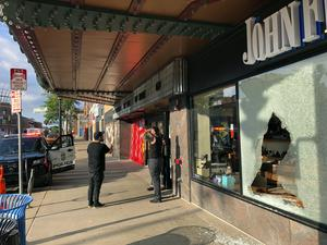 A shoe shop damaged by gunfire during the incident (Doug Glass/AP)