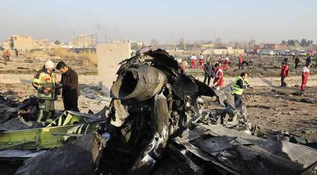 Debris at the scene of the plane crash in Iran (Ebrahim Noroozi/AP)