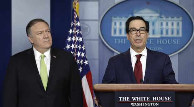 US secretary of state Mike Pompeo and treasury secretary Steve Mnuchin brief reporters at the White House about additional sanctions placed on Iran (Evan Vucci/AP)