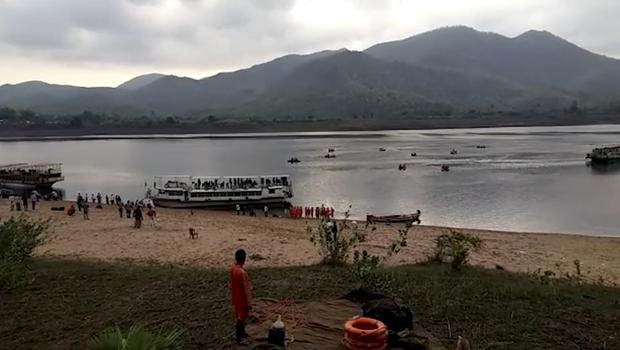 Rescuers search in the Godavari River after a ferry capsized in heavy winds (KK Productions/AP)