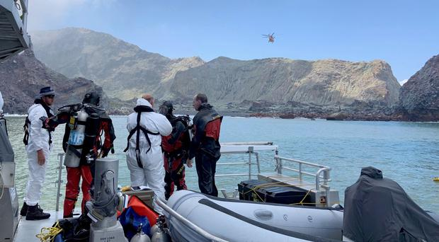 Search crews near White Island off the coast of Whakatane, New Zealand (NZ Police/AP)