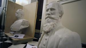 "Busts of Fitzhugh Lee, left, and James E. B ""Jeb"" Stuart, right sit in a hallway waiting to be boxed after removal from the Old House Chamber inside the Virginia State Capitol in Richmond, Virginia (Bob Brown (richmond Times-Dispatch/AP)"