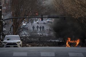 A vehicle on fire in the aftermath of the blast (The Tennesseean/AP)
