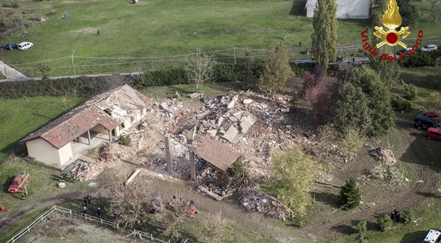 The ruins of the farmhouse in Quargnento, near Alessandria (Italian firefighters/AP)