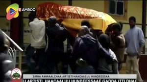 The coffin of Ethiopia singer Hachalu Hundessa is carried during the funeral in Ambo (OBN via AP)