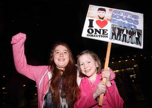 One Direction fans at the Odyssey Arena for the second show of the band's four-night run at the venue.  Left to right.  Eimear Deeds (10) and Anna Smyth (7) from Belfast