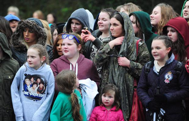 One Direction fans wait at the Culloden Hotel for a glimpse of the singers