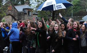 One Direction fans wait to catch a glimpse of the singers at Culloden Estate & Spa near Belfast